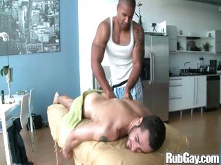 Tired gay rugby player gets a on the mark relaxing rub-down on his back and ass from a masseur stud