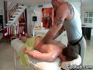 Hunky guy gets oiled up and gay massaged