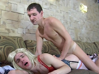 Pretty blond sissy puts on waxen gartered stockings before getting...