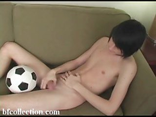 Cute twink plays with a big dick on the couch