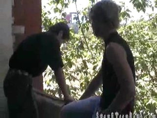 He gets a spanking outdoors
