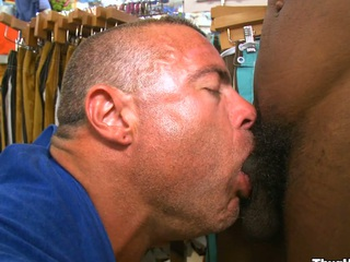 Unmitigatedly gorgeous white man sucking nice black cock with a smile on his face