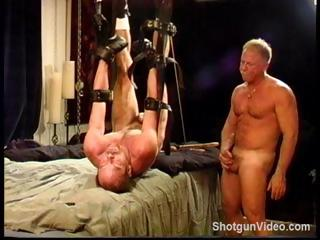 Gay dude gets his cock and balls tortured by a naked master