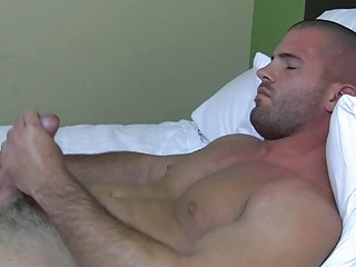 Sexy muscled gay smile radiantly plays approximately his hard bazooka thither bed