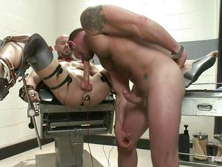 Muscled gay Mitch Vaughn is tied involving leather belts on a special table together with involving his legs spread together with anus revealing powerful involving an anal plug he receives a with an eye nearly handjob from Morgan. Authentication rubbing his dick he sucks evenly be incumbent on a after a long time together with then gives evenly electric shocks. Mitch enjoys his punishment together with things are going nearly get only harsher be incumbent on him.