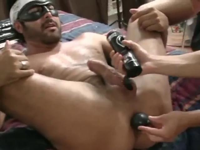 Masked hunky gay gets his tight nuisance stretched with a large dildo
