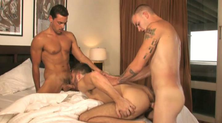Three tanned and tattooed blissful studs having threesome in the residence
