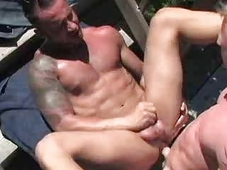 Muscle daddies having sex while sunbathing