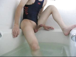Asian guy in unspecified swimsuit bathes and masturbates