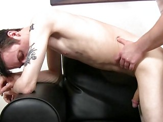 Pale skinny and tattooed twink gets slammed doggy style apart from mature hunk