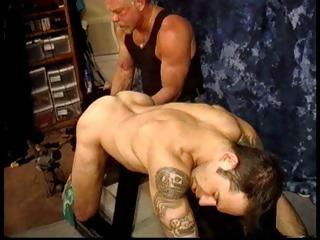 Dextrous Derek Da Silva grabs his slaves balls and cords them up tight