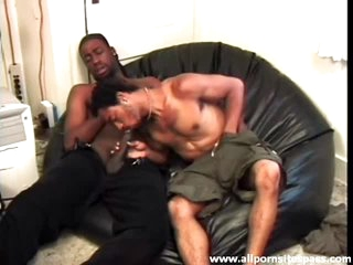 Caress over the shorts and sucking black dick