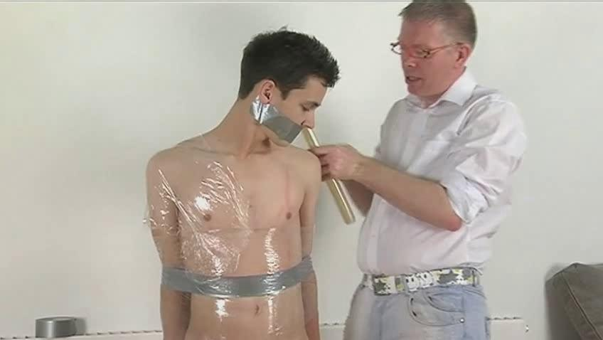 Skinny dark haired gay gets compelled and wrapped like a mummy