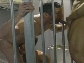Jailed Guy gets fucked by two of his INMATES, round a JAIL Cell.