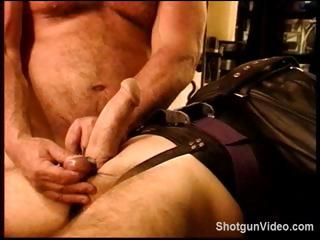 Slave gets some nasty torture from his master on his cock added to balls
