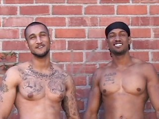 Two tattooed latin gays posing naked open-air