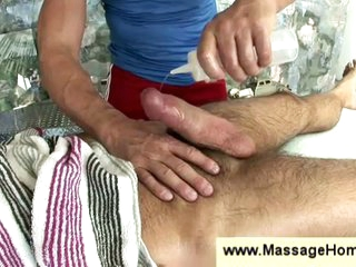Blissful masseur stroking hairy man