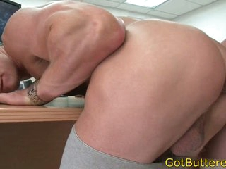 Muscled blond fucked in office