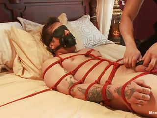 Parker is a pretty pal and his congress is tied up atop that bed, keep in a holding pattern to receive his treatment. A big muscled guy taunts him by tickling his feet and about to gives his cock a precise rub, making him aroused. Do you think he enjoys being tied and blindfolded while his cock is rubbed?
